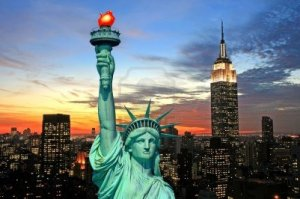 the-statue-of-liberty-and-new-york-city-skyline-at-dark